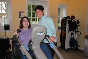 Student with developmental disabilities from The Aurora School exercising at AFC.